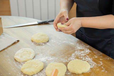close up of young housewife woman hands kneading the dough while making homemade pastry in kitchen �ookery class family traditions concept Homemade baking lesson concept. blogging concept Banque d'images