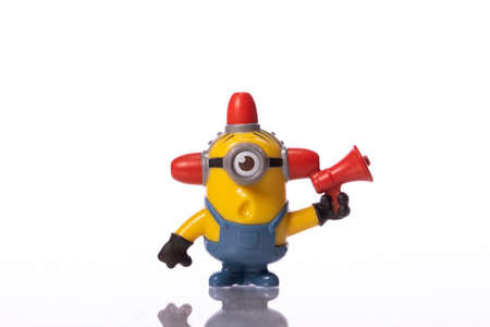 LA, CA, USA Sep 1, 2020: Toy Minion Carl from Despicable Me 2 movie isolated on white background. plastic toy sold as part of McDonalds Happy meals. character from Despicable Me 2 movie.