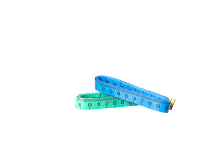 Two stacked colorful tailor metric measuring tapes isolated on white background blue and green color. Sewing meter. Traditional tailoring equipment. DIY concept.
