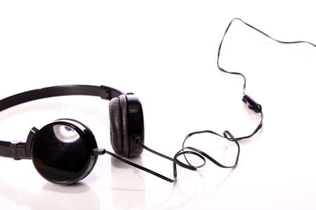 Black headphones isolated on white background. Soundcheck, online entertainment, listening digital music service, music accesories application, relaxing songs soundtrack stream concept. Copy space Banco de Imagens