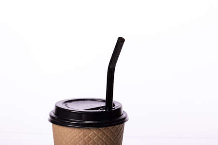 close up of black glass reusable straw sticking out of plastic lid paper takeaway cup isolated on white background. Zero waste concept, eco friendly product. Europe bans plastic straws. copy space Stock fotó
