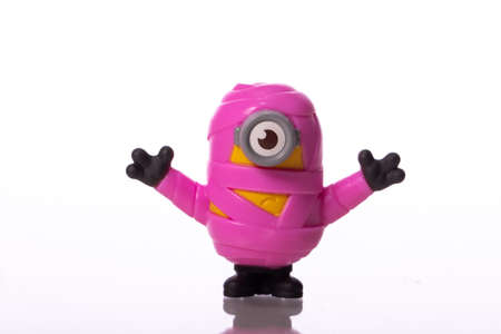 LA, CA, USA Sep 1, 2020 Toy Minion character in pink bandage from Despicable Me 2 movie isolated on white background plastic toy sold as part of McDonalds Happy meals. Redakční