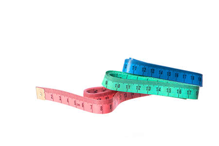 Three colored measuring tapes isolated on white background. Sewing, clothing repair, fitting, design, tailor workshop. Diet, weight loss control, healthy lifestyle, body care concept