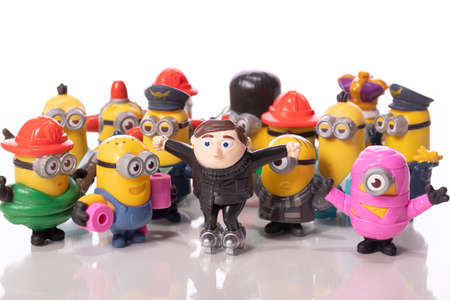 LA, CA, USA Sep 1, 2020: group of toy minions, characters from Despicable Me 2 isolated on white background. plastic toys Felonious Gru, KIng Bob, Dave, Kurt Adler from McDonalds happy meal. Redakční