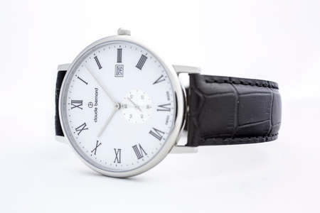 Geneve, Switzerland 01.10.2020 - Claude Bernard man swiss made watch white dial leather strap isolated. date indication 26. classic design, Roman numeral Swiss watchmaker, watch manufactory brand