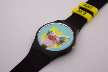 Geneve, Switzerland 07.10.2020 - Swatch childrens swiss made plastic watch, ostrich head on dial. youth hipster style watch for bright image. Swatch Group watch production 版權商用圖片