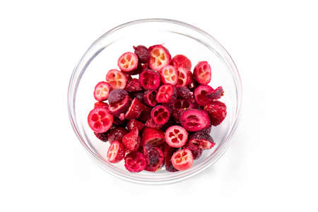 Freeze-dried organic lingonberry cowberry forest berries cutaway in glass bowl for cakes, handmade chocolates. Filling for porridge, muesli, yogurt, sauce, dressing. Pastry, natural food concept