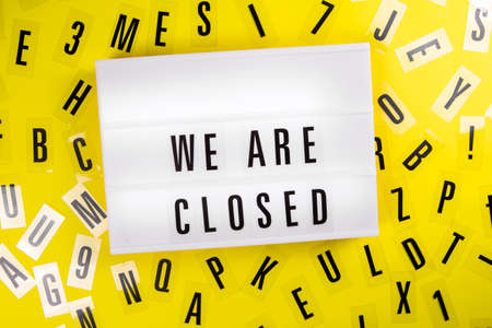 We Are Closed message on lightbox on scattered letters background of plastic alphabet Global economic crisis, quarantine due to , shutdown of restaurants and entertainment facilities concept Zdjęcie Seryjne