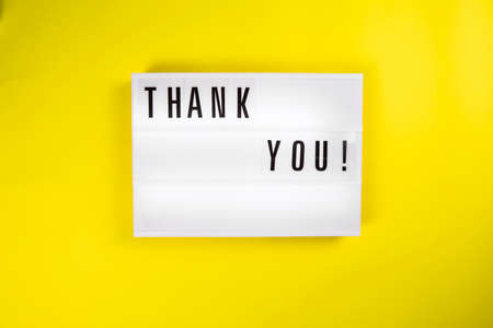 Thank You! text on lightbox on yellow background isolated. Top view, flat lay, thanks of heroes, thanking doctors, nurses and medical staff working in hospitals