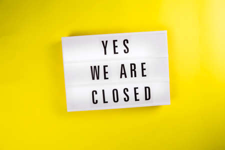 Yes We Are Closed message on lightbox on yellow background isolated. Global economic crisis, quarantine due, shutdown of restaurants and entertainment facilities concept