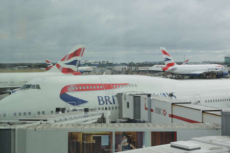London, Heathrow, UK 2.09.2019 - British Airways 747-400 airplanes docked in Heathrow airport (LHR) Preparation for departure, boarding passengers on board using Many boarding bridges to plane Publikacyjne