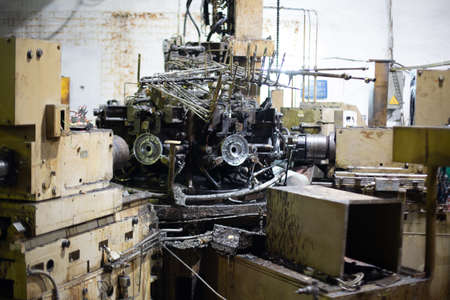 Dirty old industrial equipment with oil stains, symbol of obsolete manufactured mechanical production