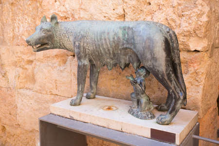 Tarragona, Spain, March 1, 2020 - Statue of She-wolf, Loba romana, one of sculpture brothers was stolen. concept of theft in tourist areas, security systems. Watch your stuff