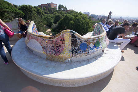 Barcelona, Spain, May 1, 2020 - whimsical bench in Guell Park, decorated with ceramic mosaics by genius architect and designer Gaudi. concept of creativity, vivid imagination, inspiration Publikacyjne