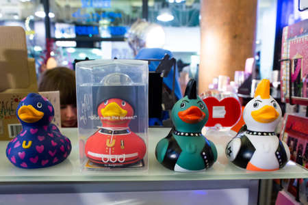 Paris, France, 1.11.2019 - Fashionable stylish designer rubber duckies in royal guard, punk and Mohawk looks made in plastic on counter of gift store. Rubbers duck with difference