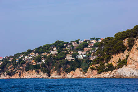 Lloret de Mar, Spain, May 1, 2020 - Private villas on high Costa Brava rocky coast. Modern mediterranean architecture, real estate with sea view. Millionaire dwelling, Gold Coast