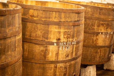 Pilsen, Czech Republic, 1.09.2019 - large oak barrels For aging beer according to ancient recipes of Pilsner Urquell brewery. Beer background. Retro style. Beer brewing traditions Copy space