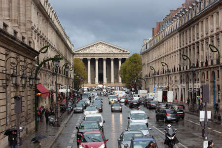 Paris, France, 1.11.2019 - View of busy rainy Royal Street and Madeleine Church, La rue Royale. center of Paris with luxury boutiques