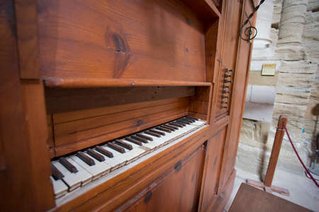 Lleida, Spain, May 1, 2020 - register control and keyboard of medieval organ of La Seu Vella cathedral. Religious music, church acoustics, ancient musical instrument concept.