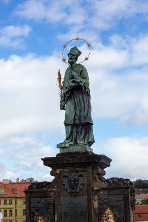 Prague, Czech Republic, 2.09.2020 - famous Statue of St. John of Nepomuk at Charles Bridge. Tours of Old Prague, travel concept, heritage of medieval Europe