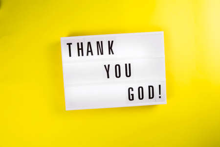 Lightbox with text message THANK YOU GOD isolated on yellow background. Concept of happiness, prayer, faith, hope, gratitude, gratefulness, survive, luck, chance, godsend, pleased, Thanksgiving Day