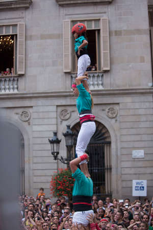 Barcelona, Spain, September 22 2019 - Vilafranca castellers team Castells performance during Fiesta de la Merce. castell is human tower built traditionally on festivals in Catalonia. UNESCO Heritage