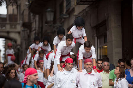 Barcelona, Spain, September 22 2019 - falcons Castells performance during Fiesta de la Merce. castell is human tower built traditionally on festivals in Catalonia. UNESCO Cultural Heritage