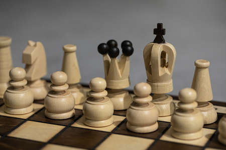 White Chess pieces on board, arranged in incorrect initial position. king is not in his Chessboard square close up. Childrens formation error, chess beginners. simplest chess lesson to arrange pieces