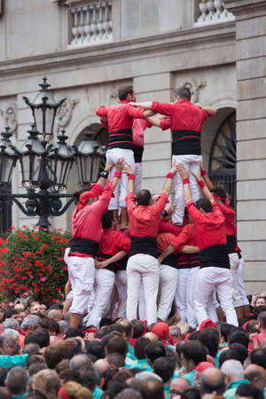 Barcelona, Spain, September 22 2019 - Castells performance during Fiesta de la Merce. castell is human tower built traditionally on festivals in Catalonia. UNESCO Intangible Cultural Heritage