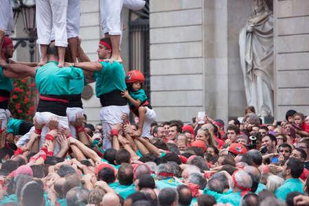 Barcelona, Spain, September 22 2019 - Vilafranca castellers team Castells performance during Fiesta de la Merce. castell is human tower built traditionally on festivals in Catalonia.