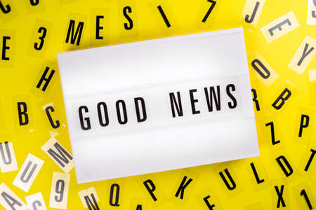 Lightbox with message GOOD NEWS on yellow background with black letters randomly scattered. Concept of positive happy news, information about success victory achievement, ad, sale, promotions Foto de archivo