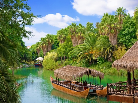 landscape and walking canoe on river in French Polynesia.