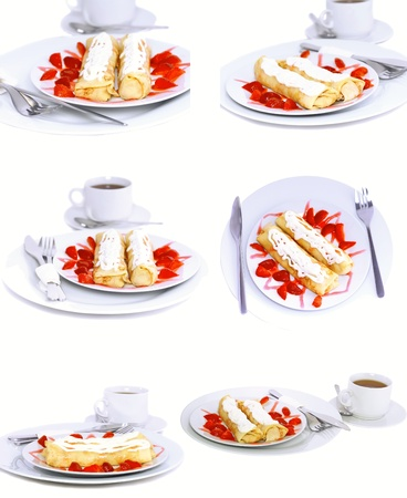 rubicund: Collection-pancakes with rolled fruit inside and strawberry around. Isolated