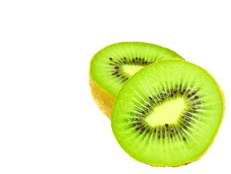 Cutting kiwi on white. Isolated over white. photo