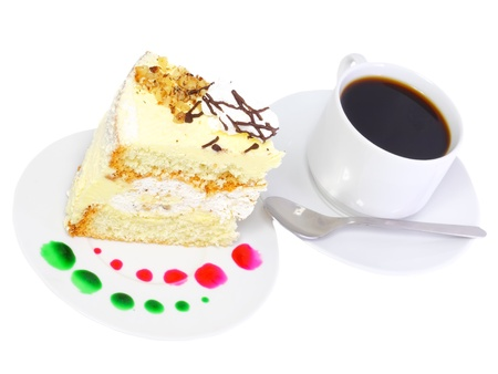 A piece of sponge cake with cup of coffee. Isolated photo