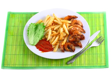 Deep-fried potatoes with fry shrimps and lettuce. Isolated over white background Stock Photo - 10202906