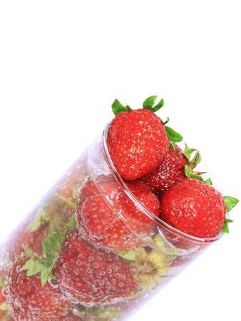 vermilion: Fragment of glass with fresh strawberries and soda on white background. Isolated