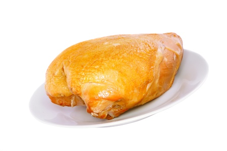 A smoked chicken on plate . Isolated over white. photo