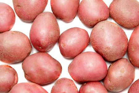 Young pink potato. Isolated over white. photo