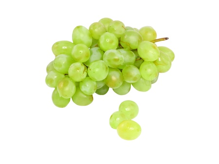 Branch of green grapes . Isolated over white photo