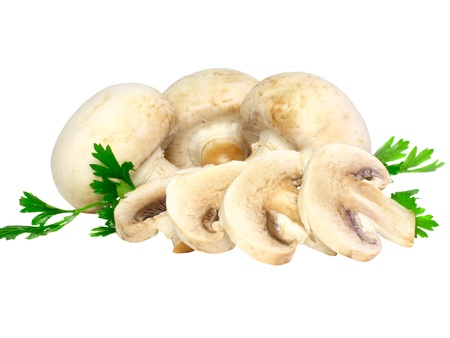 Ripe mushroom champignon with green parsley leaves isolated on white background. photo