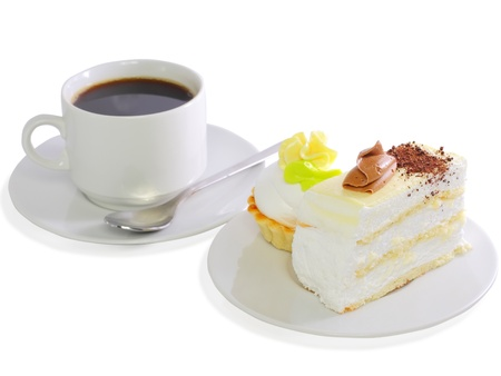 Sponge cake and baked shell with cup of coffee. Isolated photo