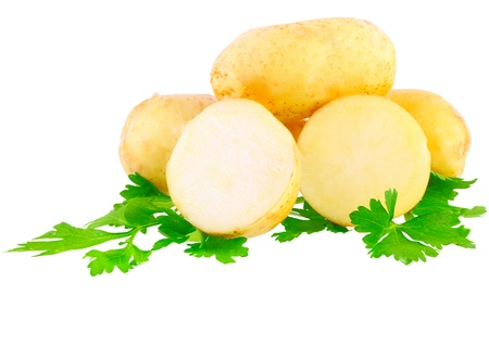 Young potatoes, decorating of parsley . Isolated over white photo