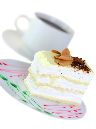 Sponge cake and on original decorating plate with cup of coffee. Isolated Stock Photo - 10228183