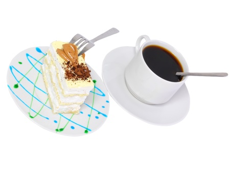 Sponge cake and on original decorating plate with cup of coffee. Isolated photo