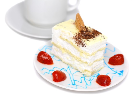 Sponge cakes, frozen strawberry with cup of coffee on plate with fruit-juice decoration . Isolated photo
