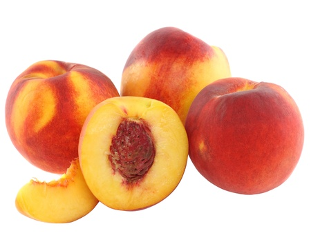 A few peaches with slice of one, on white background. Isolated photo