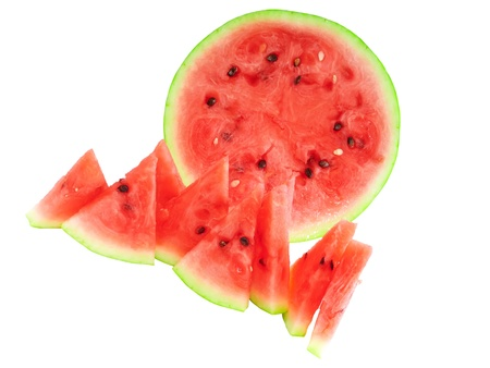 Half of watermelon with juicy slice, isolated on white. photo
