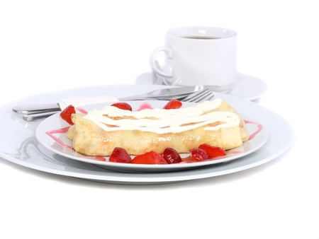 rubicund: Pankcake with cream , with rolled fruit inside and strawberry around. Isolated