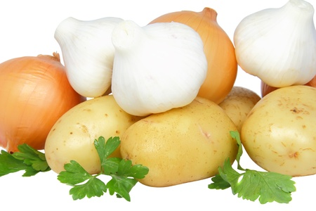 Still-life-garlic,onions decorating of parsley. Close-Up. Isolated photo